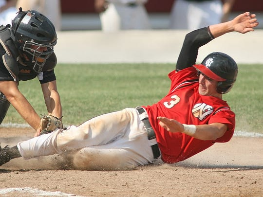 Dayne Read slides into home during a game for North