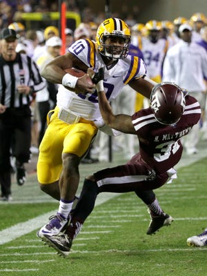LSU quarterback Anthony Jennings (10) is tackled by Texas A&M defensive back Howard Matthews (31) during the first quarter of Thursday's game.