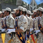 Members of Iran's Revolutionary Guard march outside Tehran in 2011.