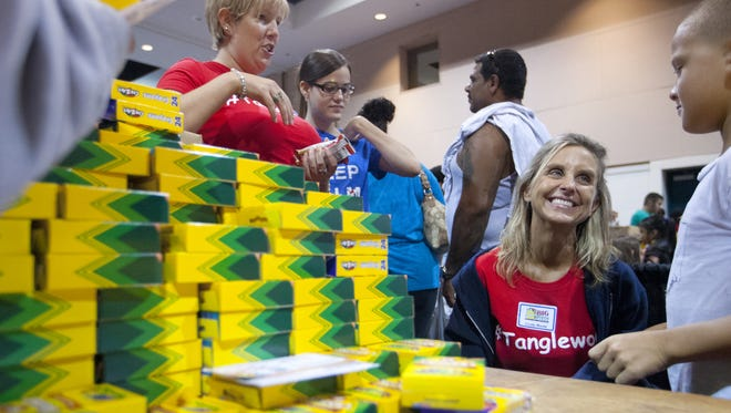 Tanglewood Elementary School teacher Cindy Maute, right, greets students at the 2014 Big Backpack Event. This year's event is Sunday, Aug. 2, at Harborside Event Center in downtown Fort Myers.