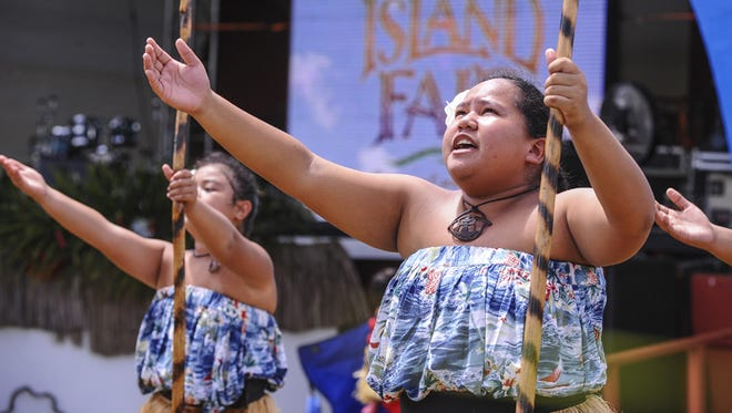 Members of Guma Taotao Lagu, and representing Vincente Benavente Middle School, perform during the 28th Annual Guam Micronesia Island Fair at the Gov. Joseph Flores Memorial Park in Tumon on June 12.Rick Cruz/Pacific Daily News/rmcruz@guampdn.com