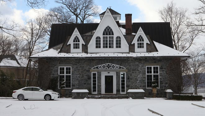 The front exterior of Pokahoe, the four-bedroom 1847 stone manor home for sale in Sleepy Hollow.