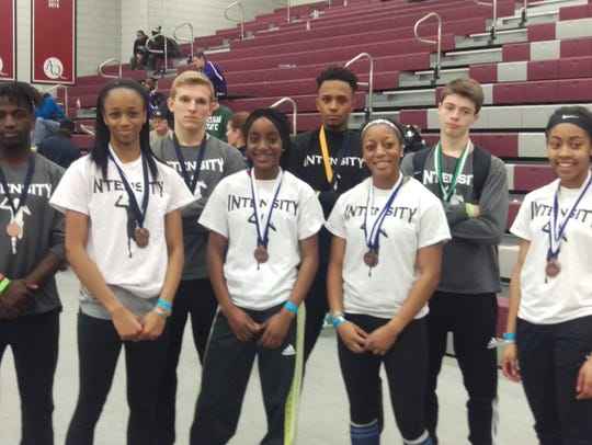 Members of the Intensity Track Club pose with their