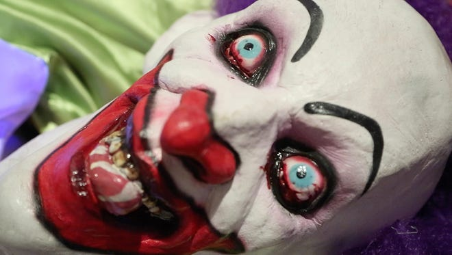 A creepy clown in the Evil on Erie haunted house Monday, October 3, 2016, in Lafayette. People have reported clown sightings in Frankfort and Lafayette.
