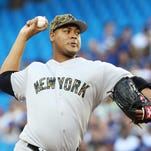 New York Yankees starting pitcher Ivan Nova throws against the Toronto Blue Jays during the first inning of a baseball game in Toronto on Monday, May 30, 2016.