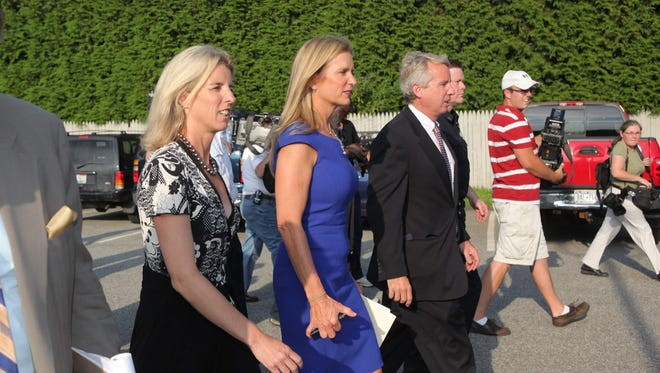 Kerry Kennedy, center, leaves after appearing to address DWAI charges at the Town of North Castle court July 17, 2012. According to a police report, Kennedy failed gaze, walk-and-turn and one-leg stand sobriety tests, swayed and had impaired speech after she was stopped for sideswipping a tractor-trailer.