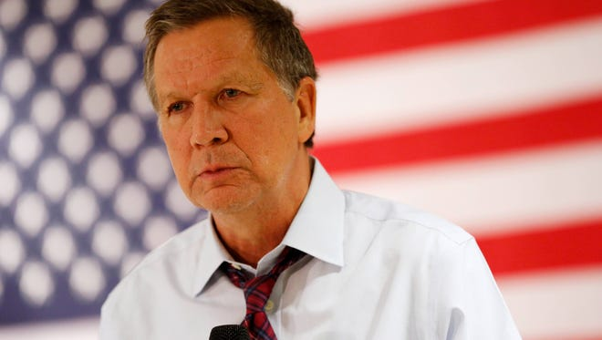 Republican presidential candidate John Kasich, the governor of Ohio, listens to a question from the audience Wednesday, Dec. 16, 2015, during a town hall meeting in Ankeny, Iowa.