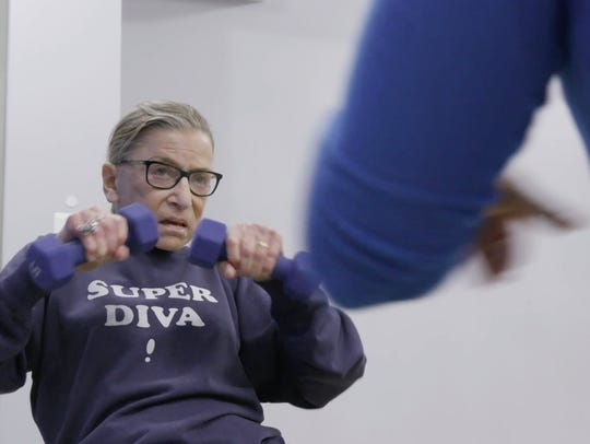 The 85-year-old justice during one of her three weekly workout sessions, in a scene from 'RBG.'