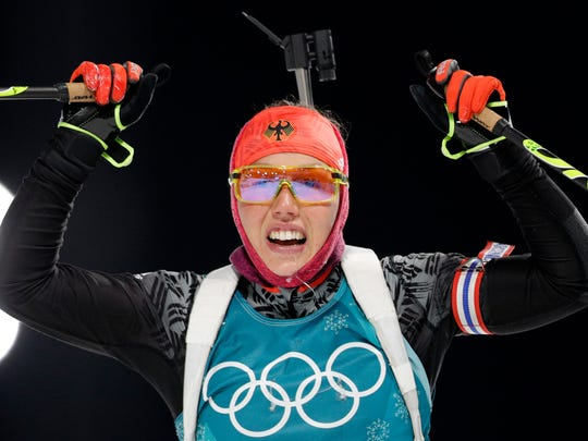 Laura Dahlmeier, of Germany, reacts after crossing the finish line during the women's 7.5km biathlon sprint at the 2018 Winter Olympics in Pyeongchang, South Korea, Saturday, Feb. 10, 2018. (AP Photo/Andrew Medichini)