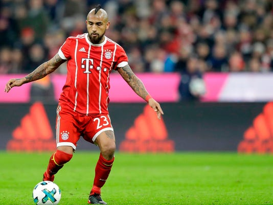 FILE - In this Nov. 18, 2017 file photo Bayern's Arturo Vidal controls the ball during the German Soccer Bundesliga match between FC Bayern Munich and FC Augsburg in Munich, Germany. Vidal has been ruled out of the side's German Cup semifinal on Tuesday and is a doubt for next week's Champions League semifinal first leg against Real Madrid. (AP Photo/Matthias Schrader, file)