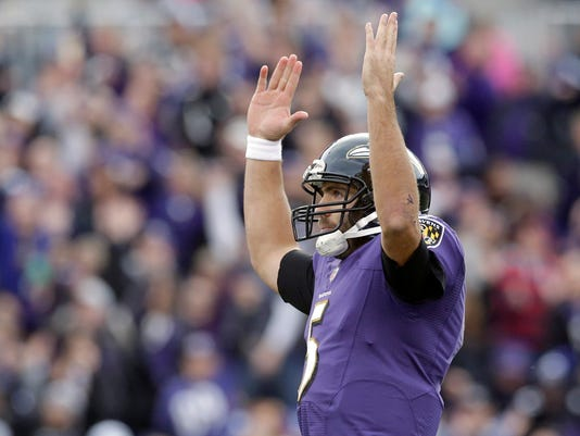Baltimore Ravens quarterback Joe Flacco reacts to running back Justin Forsett's touchdown during the second half of an NFL football game against the Tennessee Titans in Baltimore, Sunday, Nov. 9, 2014. (AP Photo/Patrick Semansky)