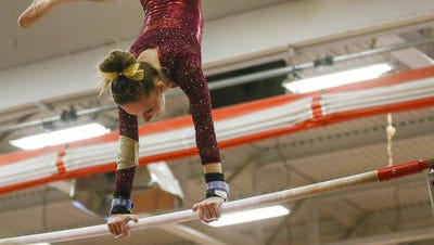 Hillsborough's Sam Ringel performs on the uneven bars at the Skyland Conference Championships on Oct. 21.