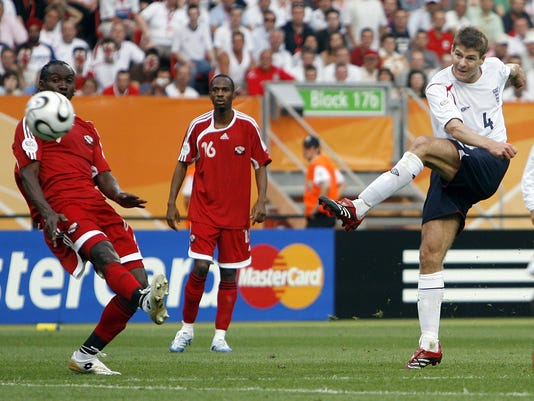 """FILE - In this Thursday, June 15, 2006 file photo, England's Steven Gerrard, right, shoots to score his side's second goal against Trinidad and Tobago during their World Cup Group B soccer match in Nuremberg, Germany.  Gerrard, the former Liverpool and England captain, announced his retirement from professional soccer on Thursday, Nov. 24, 2016 and said he is considering a """"number of options"""" about his next career move.  (AP Photo/Kevork Djansezian, File)"""