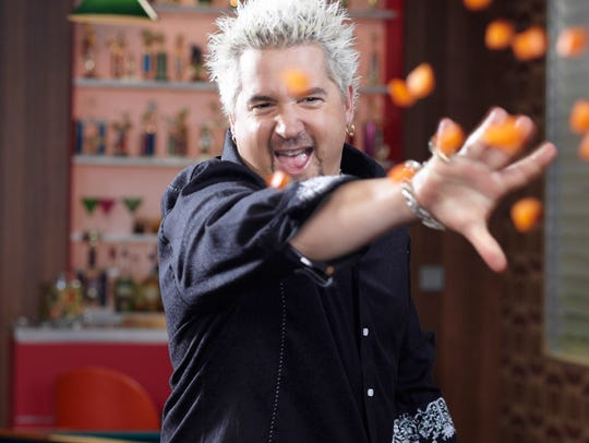 Guy Fieri, on the set of his Food Network show GUY