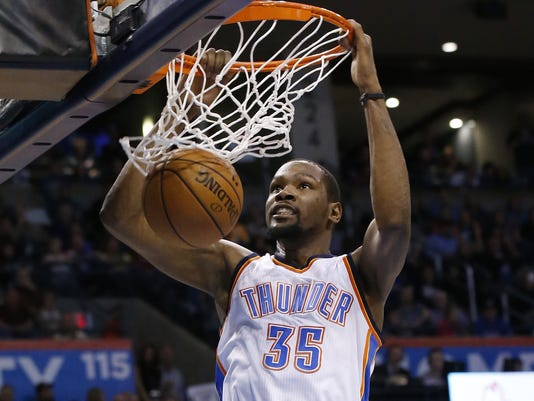 Oklahoma City Thunder forward Kevin Durant dunks in the third quarter of an NBA basketball game against the Minnesota Timberwolves in Oklahoma City, Friday, Jan. 15, 2016. Oklahoma City won 113-93. (AP Photo/Sue Ogrocki)