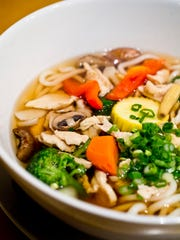 Asiana Noodle Shop soup with bok choy, mushrooms, broccoli, carrots, peppers, chicken and scallions and noodles.