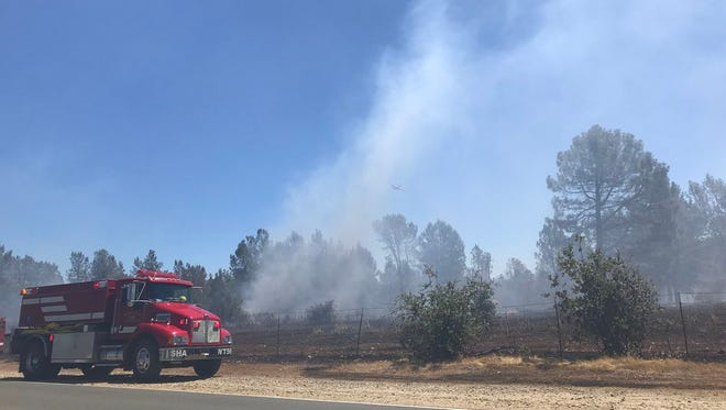 Firefighters are battling a fire that broke out Saturday, June 23, 2018 in Happy Valley,