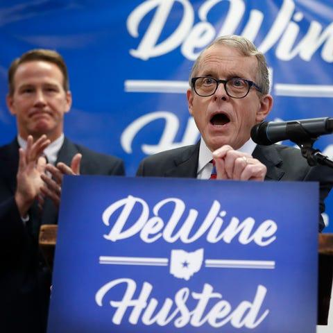 Ohio Attorney General Mike DeWine, right (AP...