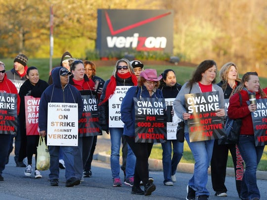 Verizon workers march on a picket line in Robbinsville.