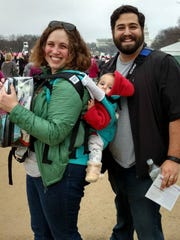Krista and Mike Rosolino and their baby daughter at