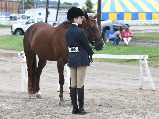 Alexis Buchanan and Sassy wait to show at the fair on Wednesday. The horse show at the Muskingum County Fair had to relocate to the track, and several events were cancelled because of rain.