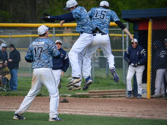 Livonia Stevenson players get into the celebratory mood after finishing off a 9-7 win over Livonia Franklin in the City Championship final.