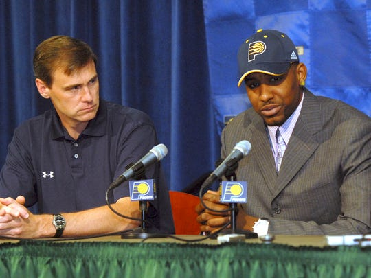 Indiana Pacers coach Rick Carlisle, left, listens as Pacers first-round NBA pick Shawne Williams takes questions from the media at a news conference at Conseco Fieldhouse, June 29, 2006.