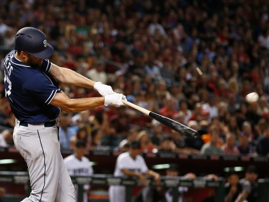 San Diego Padres' Jordan Lyles connects for a two-run single against the Arizona Diamondbacks during the fourth inning of a baseball game Friday, Sept. 8, 2017, in Phoenix. (AP Photo/Ross D. Franklin)