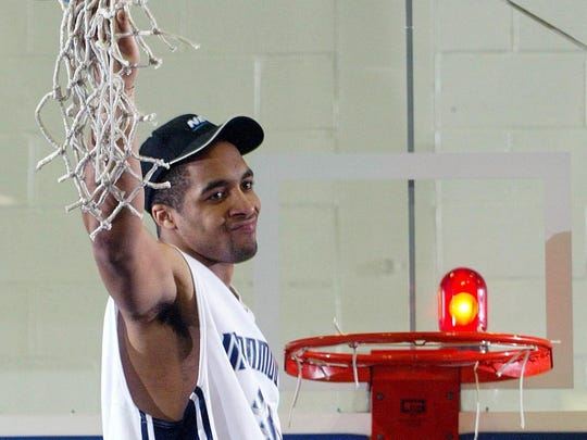 Monmouth's Blake Hamilton cuts downt he net after the Hawks won the NEC  championship to reach the NCAA Tournament in 2004.