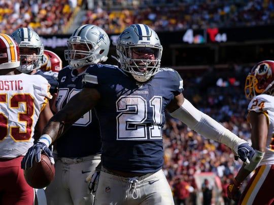 Dallas Cowboys running back Ezekiel Elliott (21) celebrates scoring in the second half of an NFL football game against the Washington Redskins, Sunday, Sept. 15, 2019, in Landover, Md. (AP Photo/Mark Tenally)