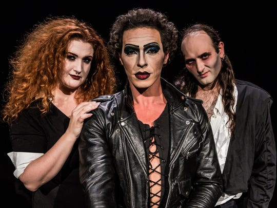 The shadow cast includes regulars (from left) Leslie Pfau as Magenta, Charles Parnell as Frank N. Furter and Michael Grimm Lamoureaux as Riff Raff.