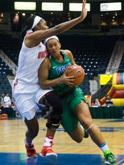 Florida Gulf Coast University senior, Mikala McGhee, drives to the hoop as Ohio State University freshman, Tori McCoy, plays defense during game three of the Gulf Coast Showcase tournament at Germain Arena on Friday, November 25, 2016 in Estero, Fla. Ohio State University won and will be moving on in the tournament.