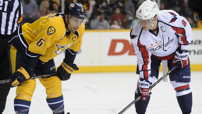 Predators defenseman Shea Weber (6) and Capitals right wing Alex Ovechkin (8) exchange words before a faceoff during the second period at Bridgestone Arena on Sunday.