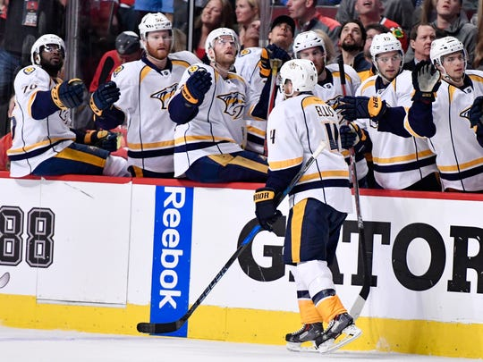 Nashville Predators defenseman Ryan Ellis (4) is congratulated for his goal in the first period of game two in the first-round NHL playoff series at the United Center, Saturday, April 15, 2017, in Chicago, Ill.