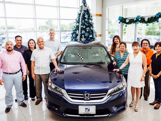 The Filipino Community of Guam is organizing the raffle of a 2015 Honda Accord to benefit the University of Guam Endowment Foundation. Pictured from left: Norman Analista, UOG Director for Development and Alumni Affairs and FCG 1st vice president, Alan Perez, Honda sales manager, Janiece Sablan, UOG Endowment Foundation, executive director, Robert Underwood, UOG president, Jay Jones, Triple J Enterprises, senior vice president, Kaye Custodio, FCG public relations officers, Gloria Baguinon, FCG peace officer, Nita Baldovino, FCG president, Beth Cena, FCG assistant treasurer, and Jesusa Umbrero, FCG assistant secretary.