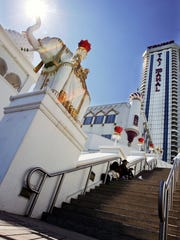 People rest in the shade near an elephant statue at the Trump Taj Mahal in Atlantic City. After the casino went into bankruptcy the year after it opened, Michael MacLeod, whose studio made giant elephant statues and faux boulders for the complex, recalls, 'We got next to nothing… I took a big hit.'