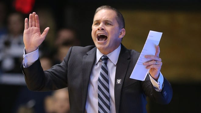 Butler Bulldogs head coach Chris Holtmann calls in a play to his players in the first half of their game. Mar 3, 2015; Indianapolis, IN, USA; [CAPTION] at Hinkle Fieldhouse. Mandatory Credit: Matt Kryger-USA TODAY Sports
