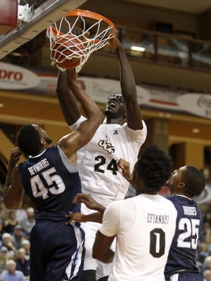 UCF's Tacko Fall (24) dunks over Villanova's Darryl Reynolds (45) during the first half of the Charleston Classic final.