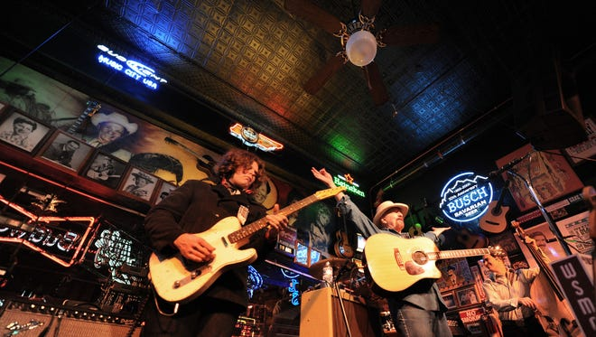 In this file image, J.D. Simo and Don Kelley of the Don Kelley Band at Robert's Western World on Broadway in downtown Nashville.