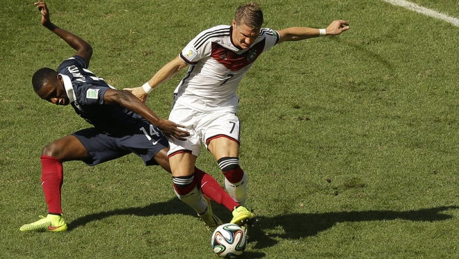 France's Blaise Matuidi, left, and Germany's Bastian Schweinsteiger fight for the ball during their quarterfinal match. Matuidi was the French player to accept his silver medal on Sunday.  France's Blaise Matuidi, left, and Germany's Bastian Schweinsteiger challenge for the ball during the World Cup quarterfinal soccer match between Germany and France at the Maracana Stadium in Rio de Janeiro, Brazil, Friday, July 4, 2014. (AP Photo/Thanassis Stavrakis)