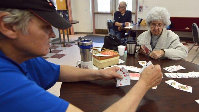 "Joseph Slenker, 66 at left, and Marie Miller, 89, play ""Kings on the Corner"" at Yorktown Senior Center, Monday, May 15, 2017.  John A. Pavoncello photo"