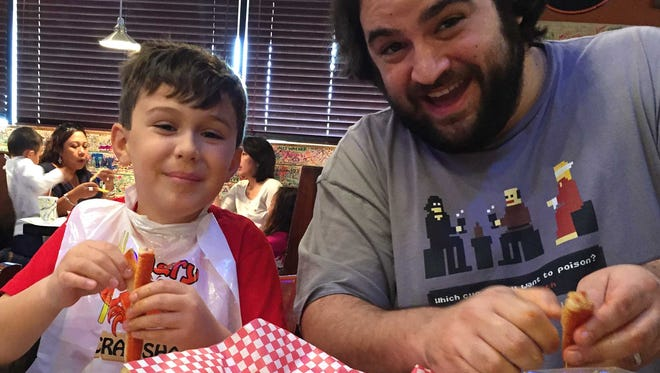 Matteo Armato and his father, dining critic Dominic Armato, eat snow crab at Angry Crab Shack