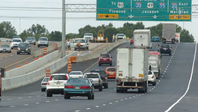Traffic moves north on I-55 in Jackson. Jackson-area auto insurance rates are $140 above the national average, and also higher than the state average, a new report finds.