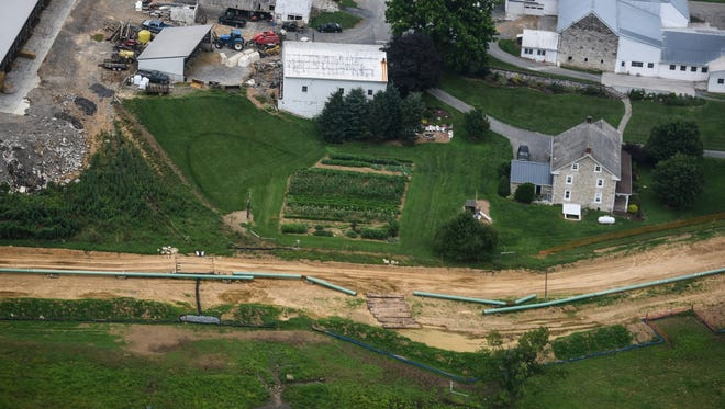 """In this July 5, 2017, file photo, pipes for the Sunoco Mariner East pipeline are placed in South Lebanon Township, Pa. The Pennsylvania Department of Environmental Protection announced Wednesday, Jan. 3, 2018, it has ordered Sunoco to halt construction of the Mariner East 2 natural gas pipeline across the southern part of the state, citing a series of spills and other """"egregious and willful violations"""" of state law."""