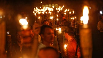 """Multiple white nationalist groups march with torches through the University of Virginia campus in Charlottesville, Va., on Friday, Aug. 11, 2017. The chanted, """"Jews will not replace us."""""""