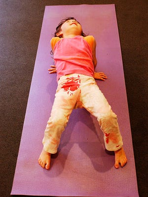 Teaching students to do yoga helps keep them connected.