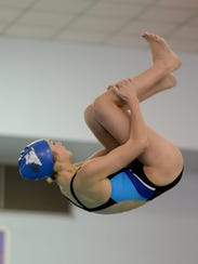 Centerville's Jolie Rusznak dives during a dual swimming