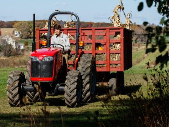 Alex Dobratz of Oconomowoc gives visitors a hay ride at Shady Maple Farm in Sussex.