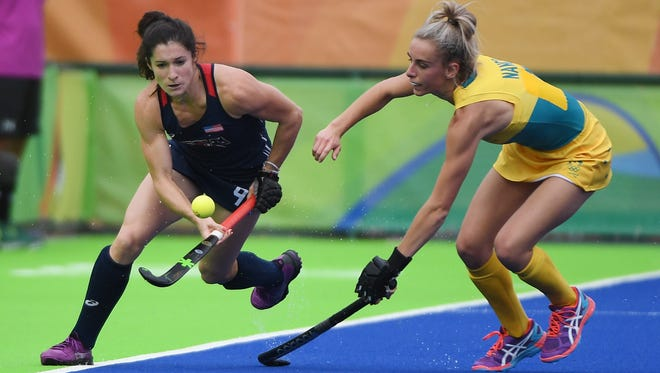 United States and Cherry Hill native midfielder Michelle Vittese (9) controls the ball as Australia defender Anna Flanagan (9) defends during the women's team first round during Monday's game. The Americans won 2-1.