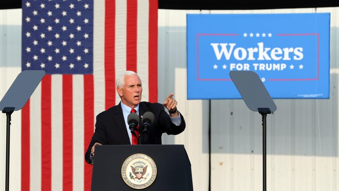 Vice President Mike Pence speaks at a Workers for Trump rally at the Muskingum County Fairgrounds in Zanesville on Wednesday.
